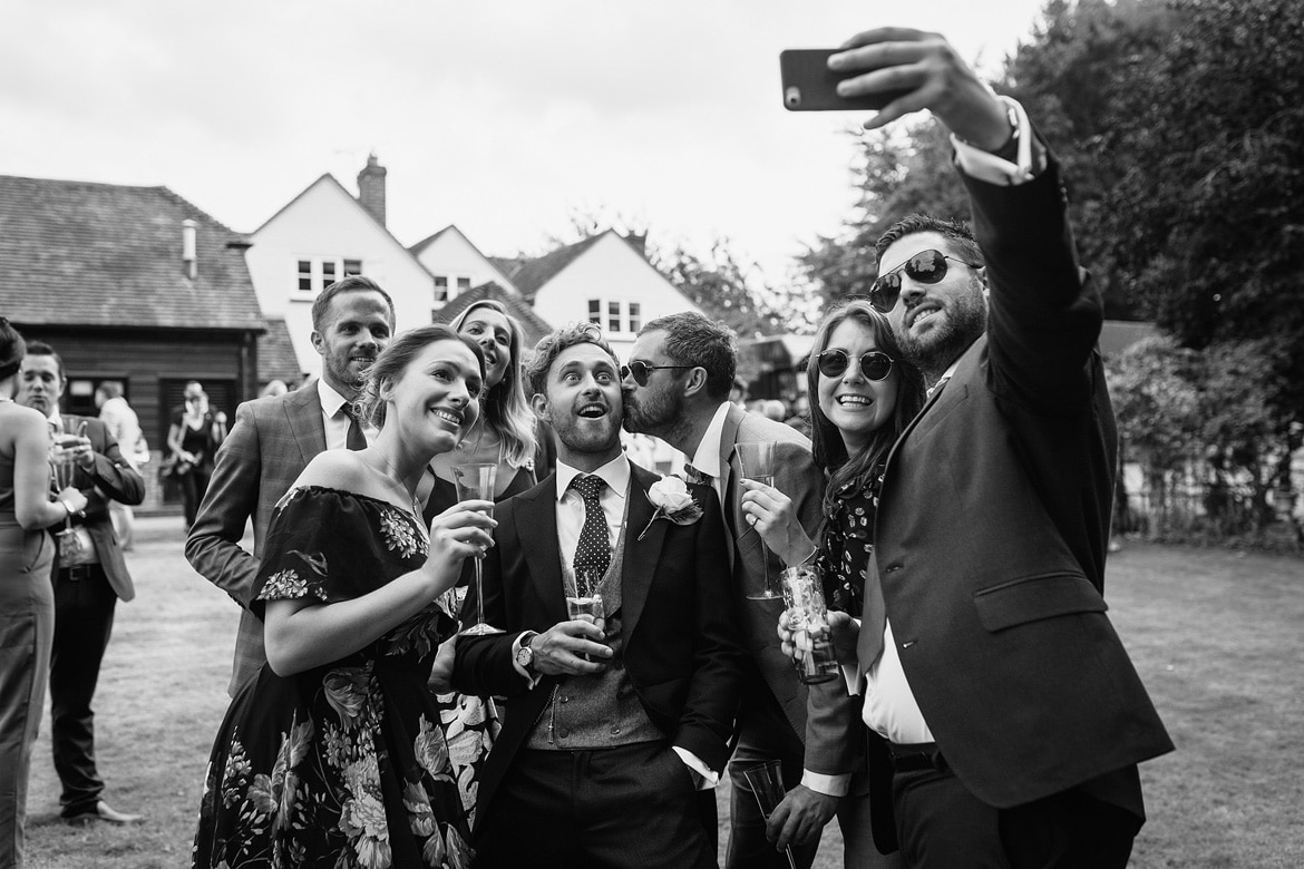 the groom and his friends take a selfie
