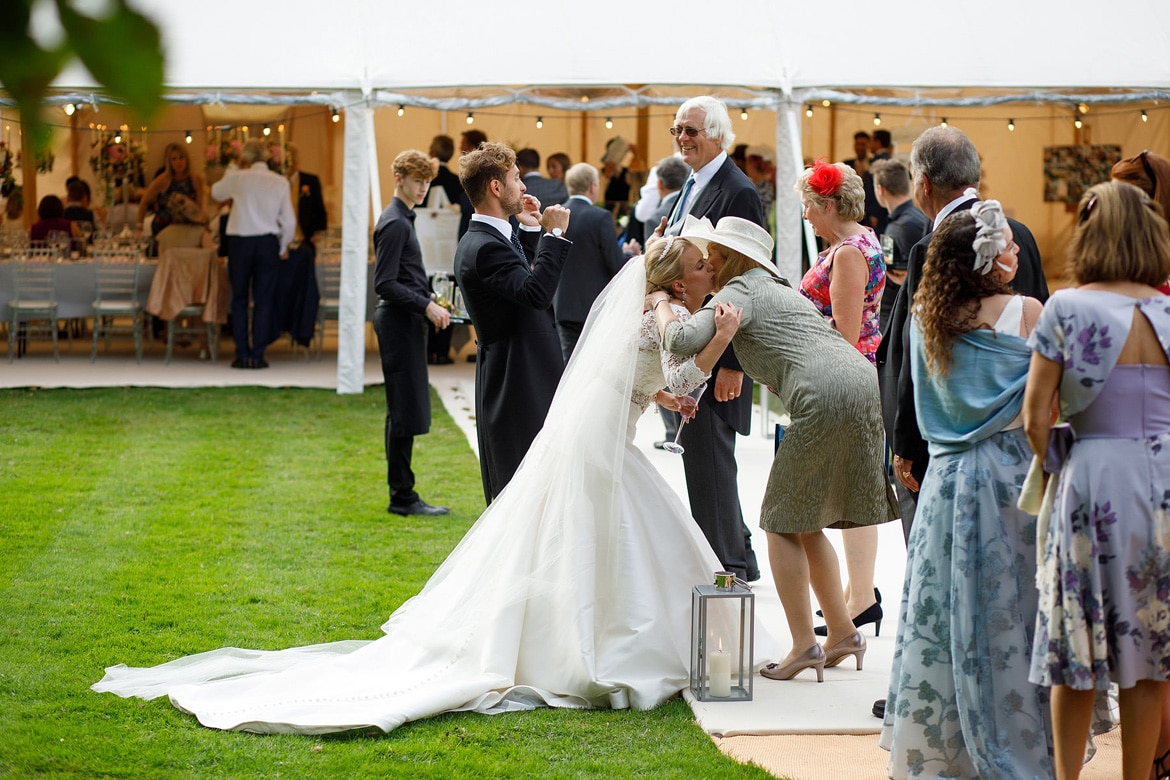 the receiving line at a summer marquee wedding