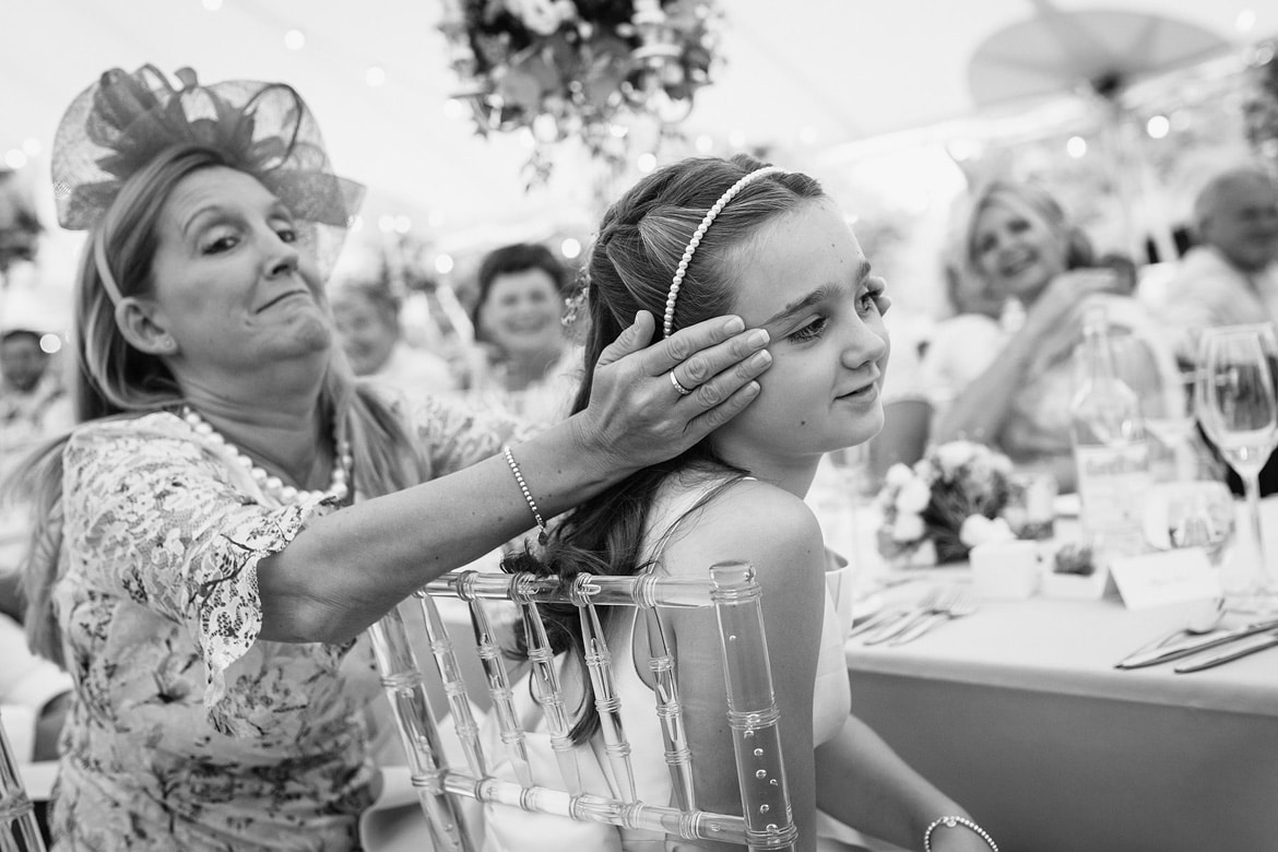 a guest covers her daughters ears during the speeches