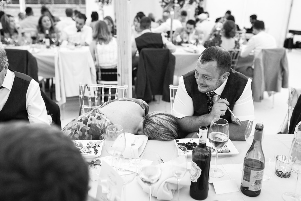 guests laugh during the wedding breakfast