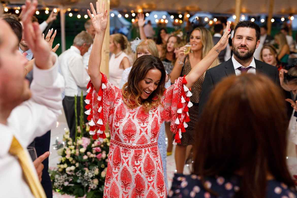 guests dancing at a summer marquee wedding
