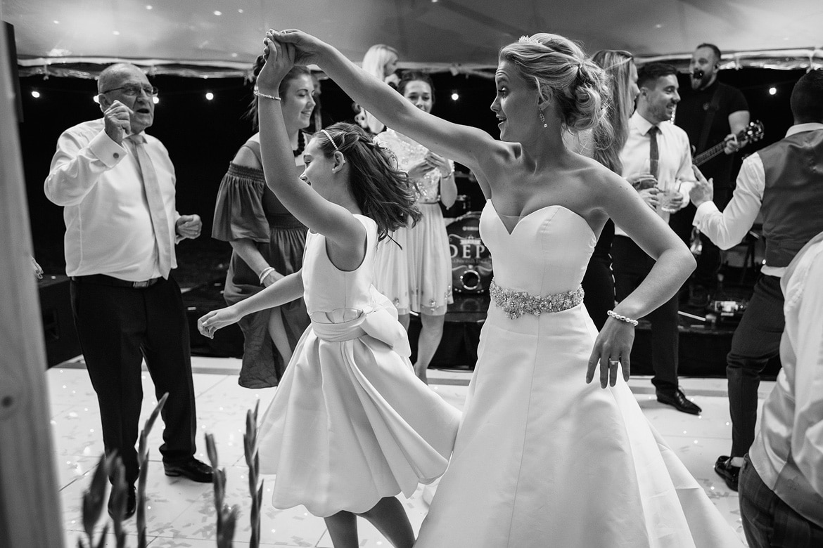 the bride dances with a flowergirl
