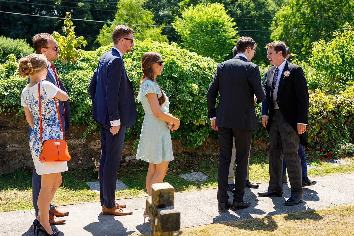 the groom greets guests at pennard house church