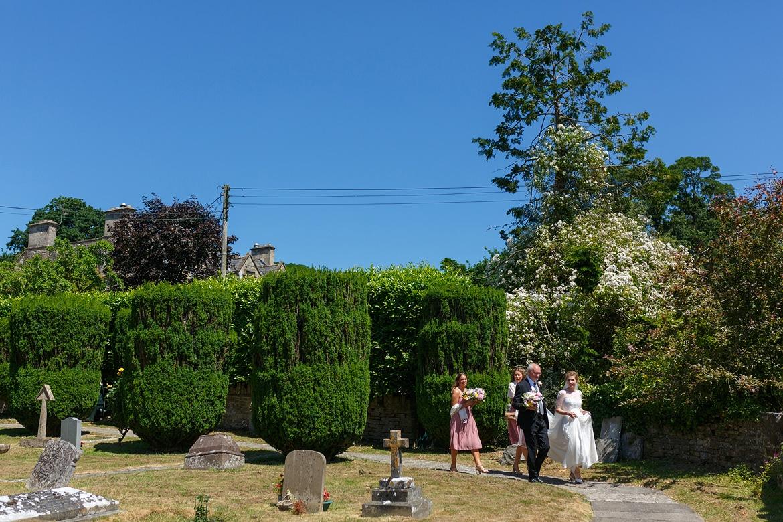 into the churchyard