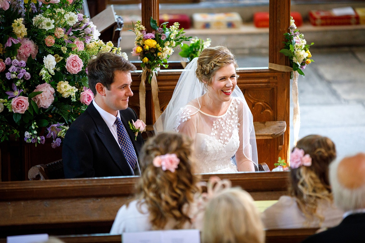michelle and george smile during their wedding ceremony at pennard house