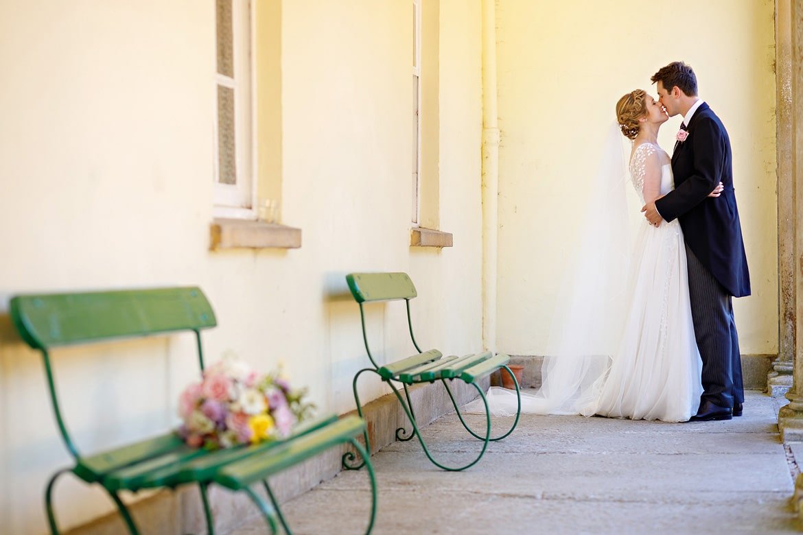 bride and groom embrace at pennard house