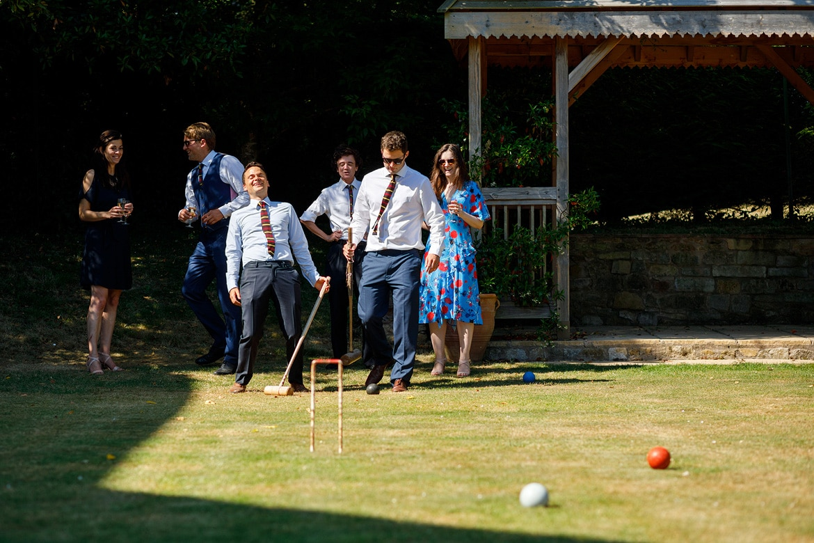 guests playing croquet