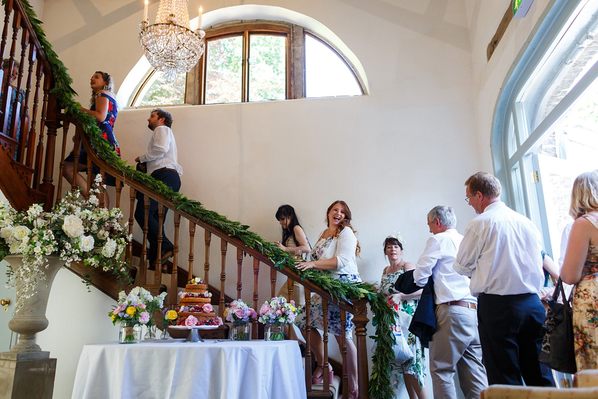 guests enter the coach house for the wedding breakfast