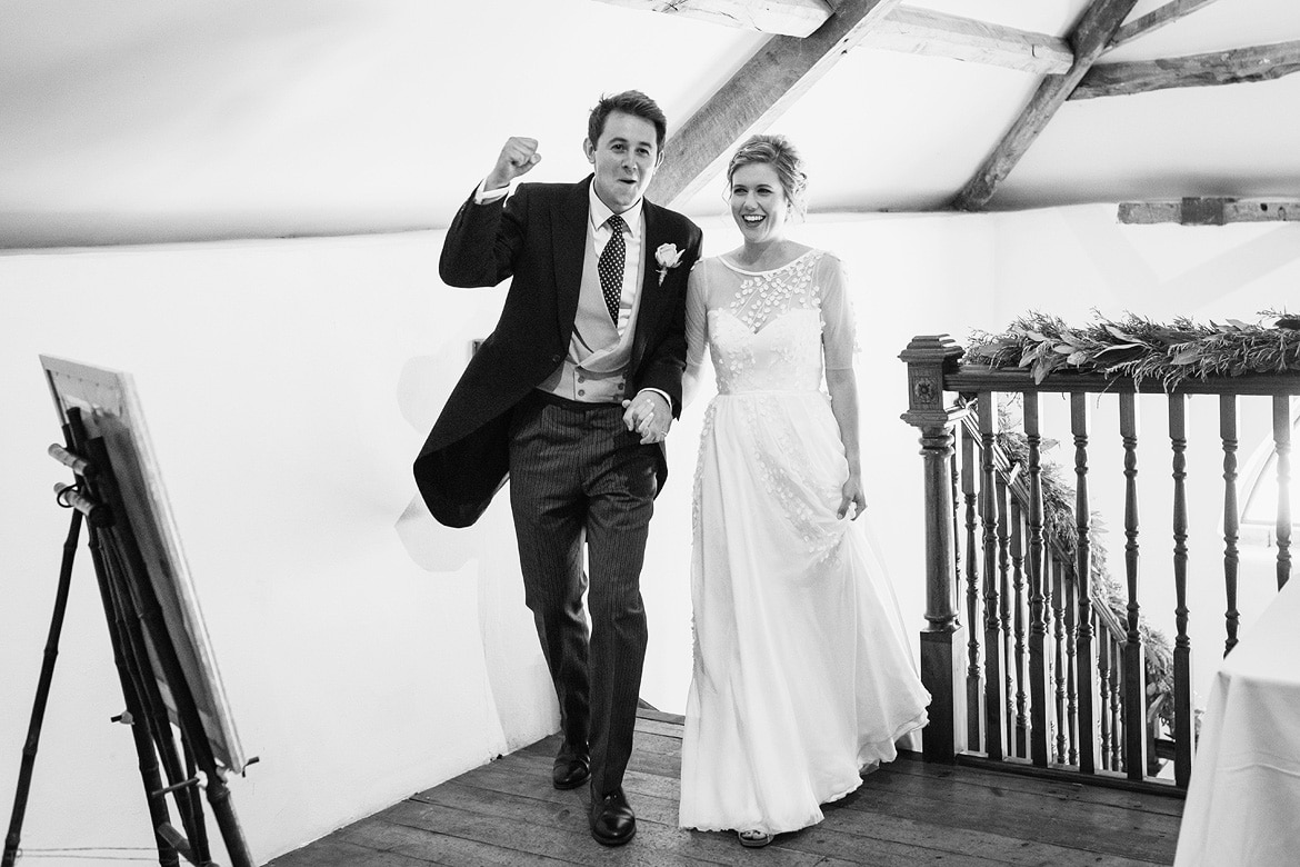 bride and groom enter the coach house at pennard