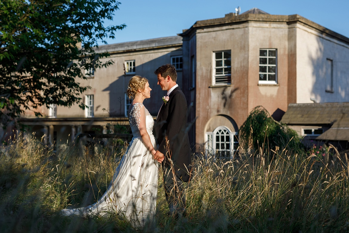 bride and groom wedding photos in front of pennard house