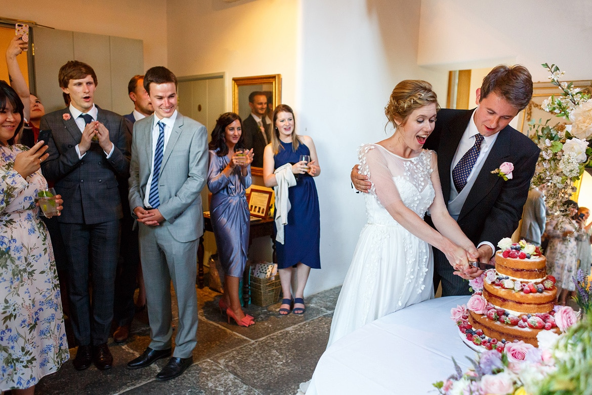 cutting the cake in the coach house