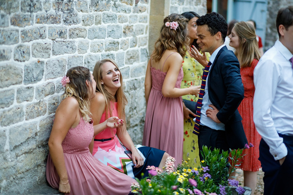 guests laugh outside the coach house