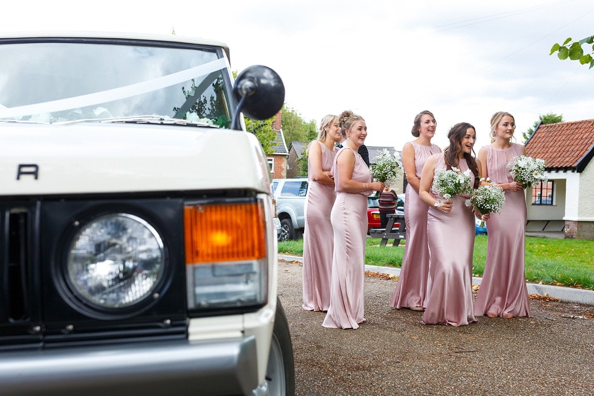 bridesmaids wait with the bride
