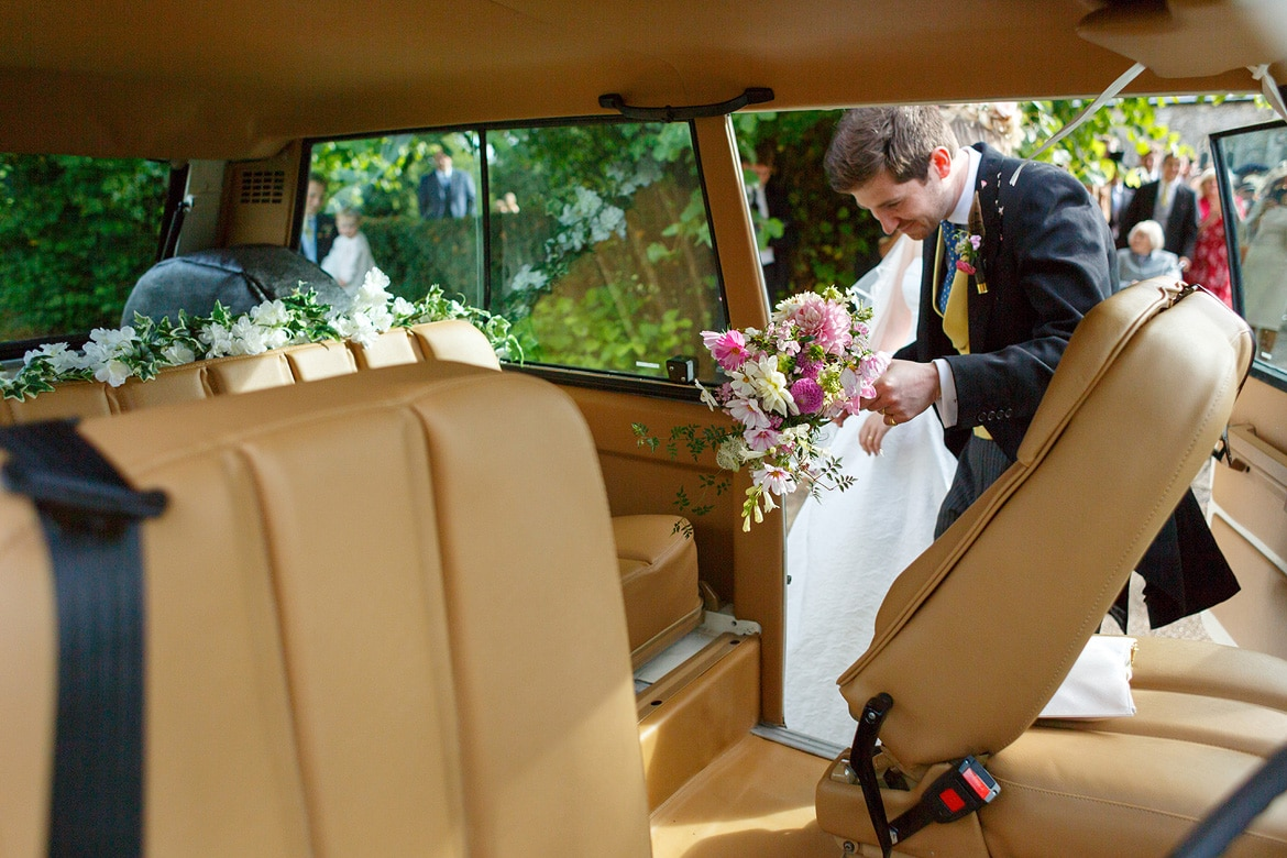 getting into the wedding car