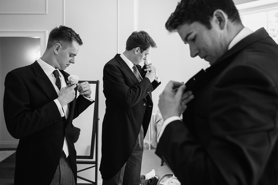 the boys fix their buttonholes