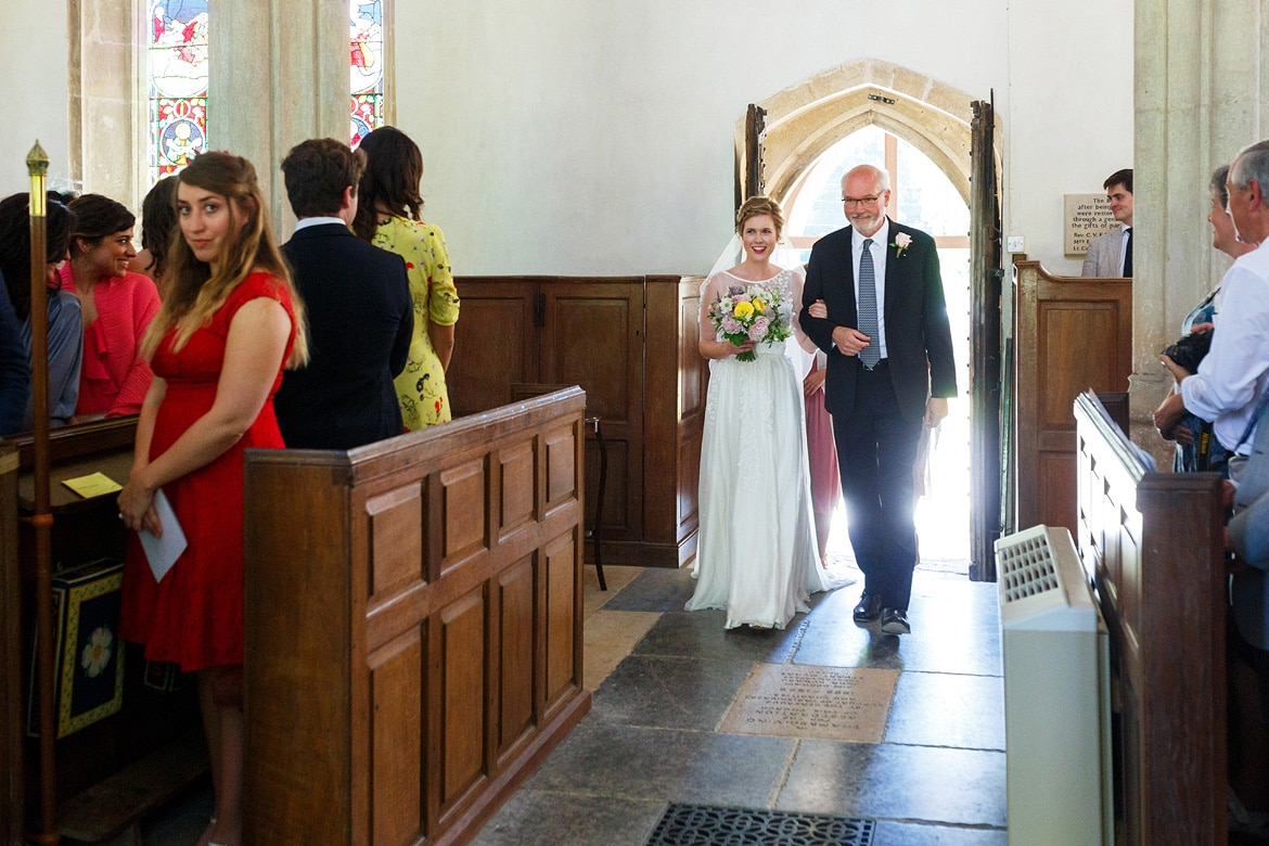 a bride and her father walk into pennard house church