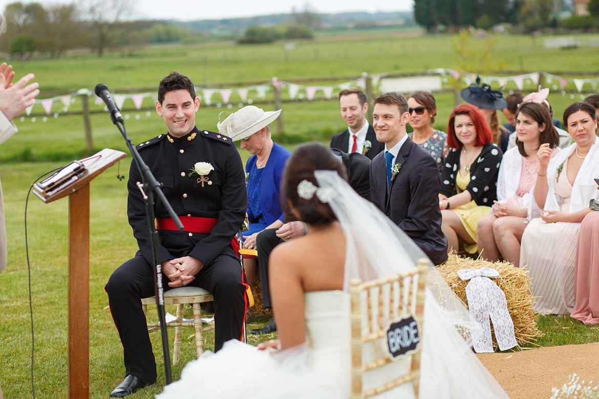 a nervous look from the groom at an outdoor wedding at godwick hall