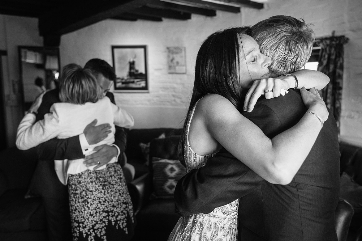 a bride hugging her father at a cley windmill wedding