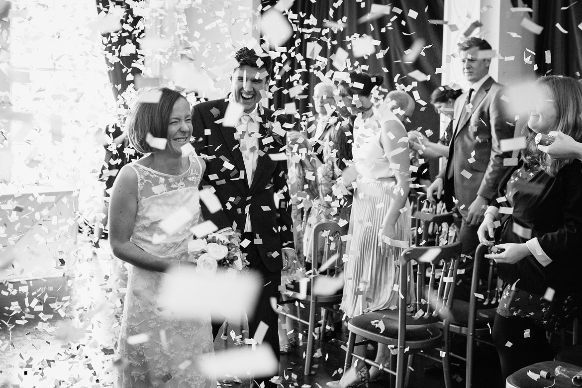 confetti after the ceremony for the bride and groom