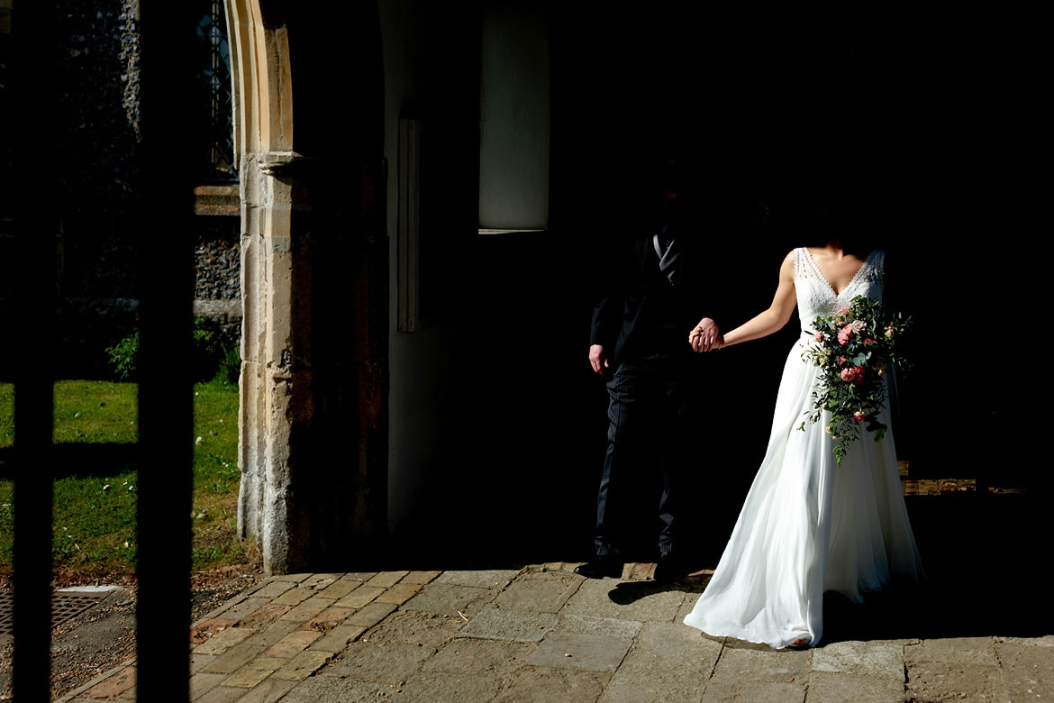 bride and groom leave aldeburgh church