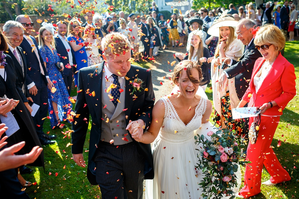 walking through the confetti at an aldeburgh wedding