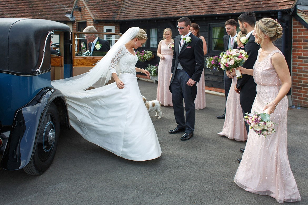 a bride glides from her vintage rolls royce