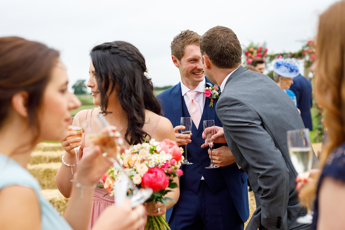 a guest congratulates the groom at godwick barn