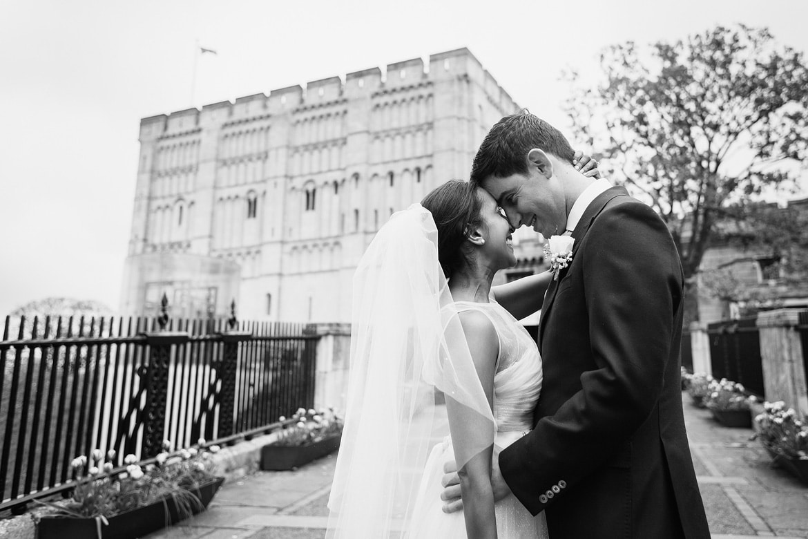 bride and groom together outside norwich castle