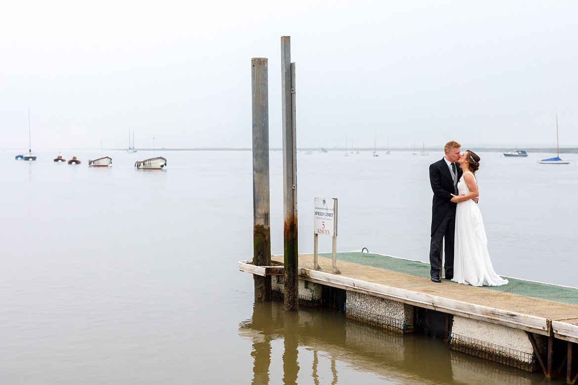 bride and groom in the mist at their aldeburgh yacht club wedding