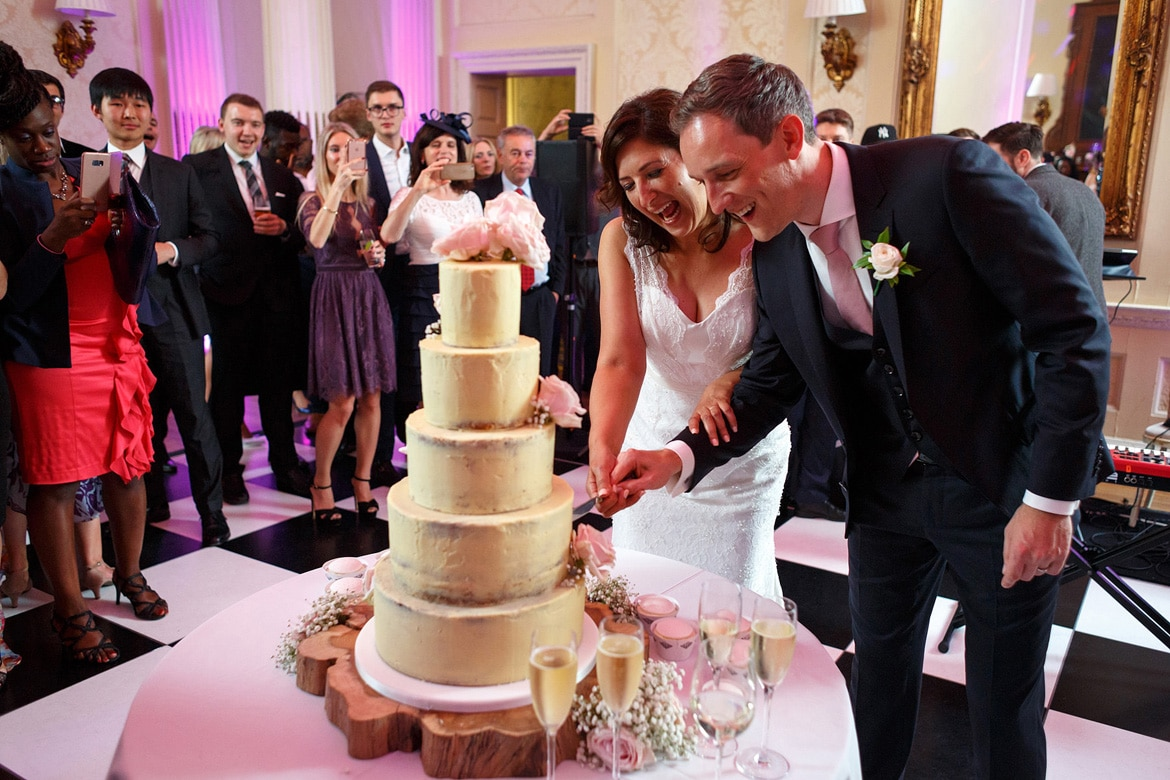 cutting the cake at a hedsor house wedding