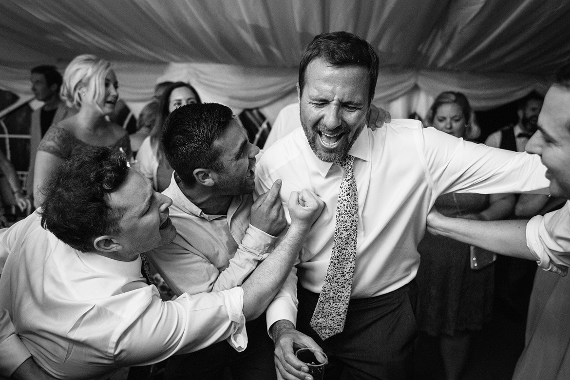 a groom dances with his guests