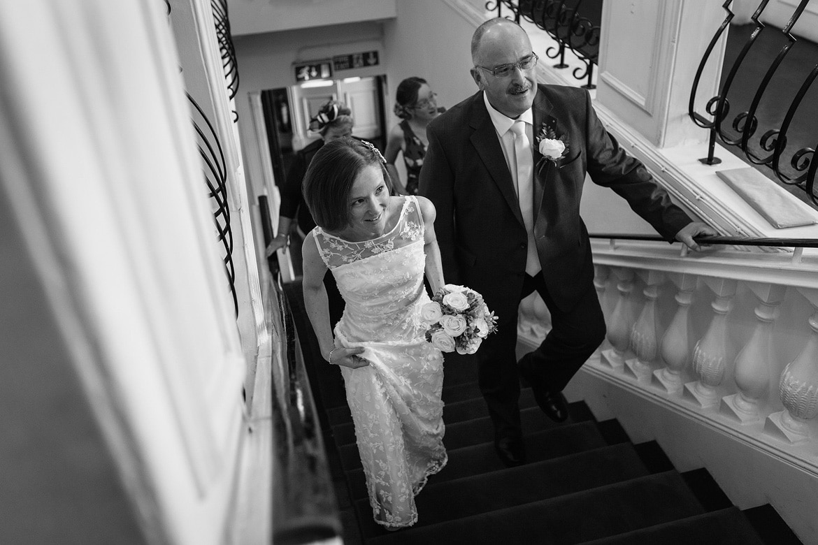 susie and her father walk upstairs