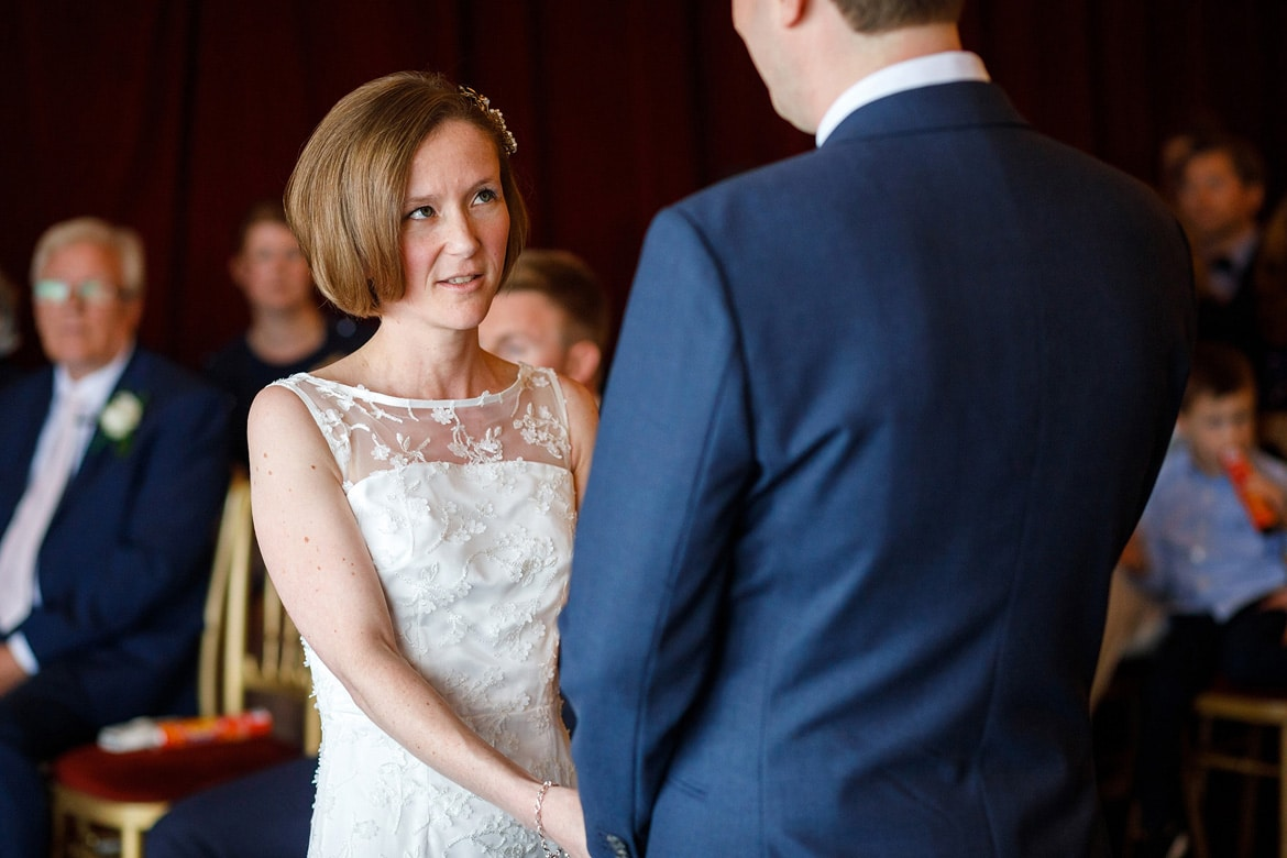 susie looks at steve during the wedding vows