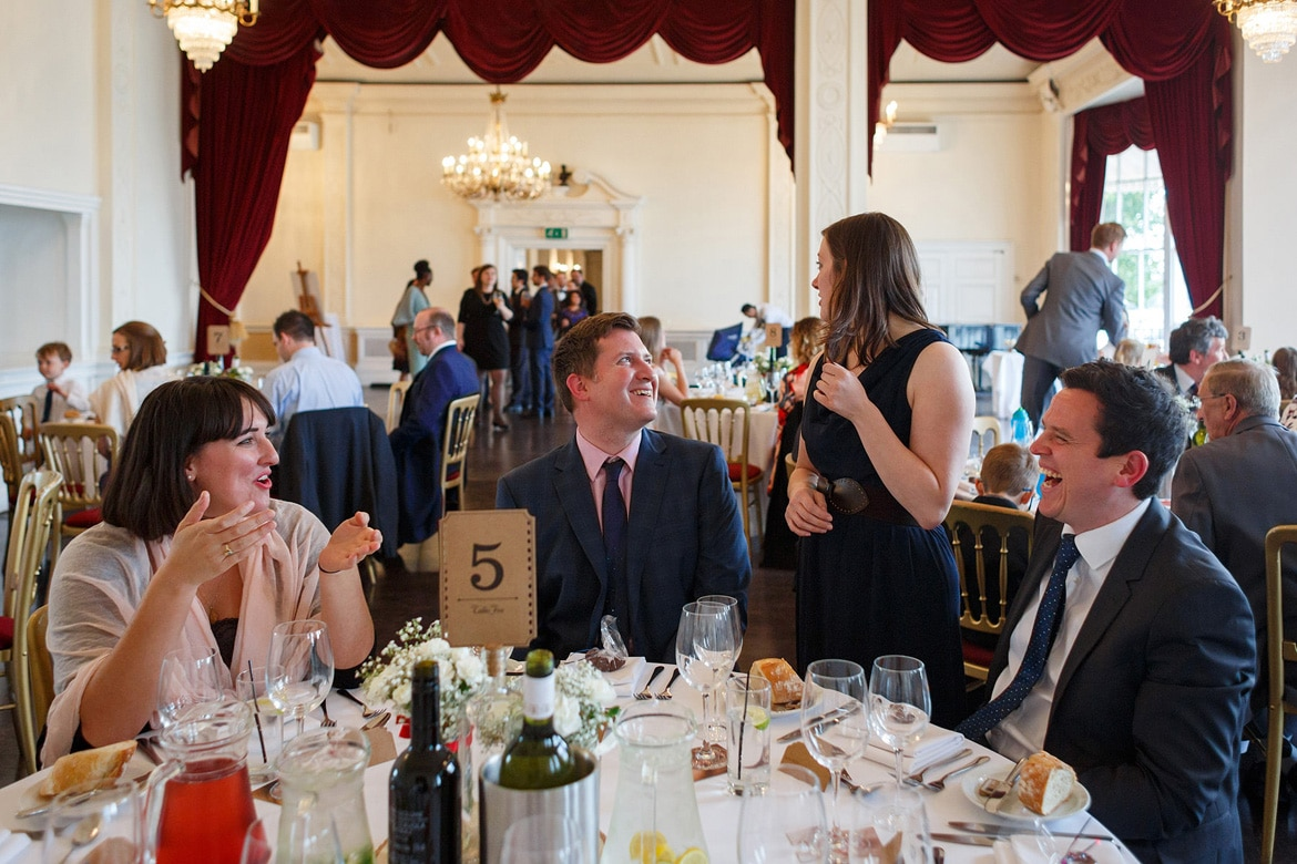 guests talk at the wedding breakfast