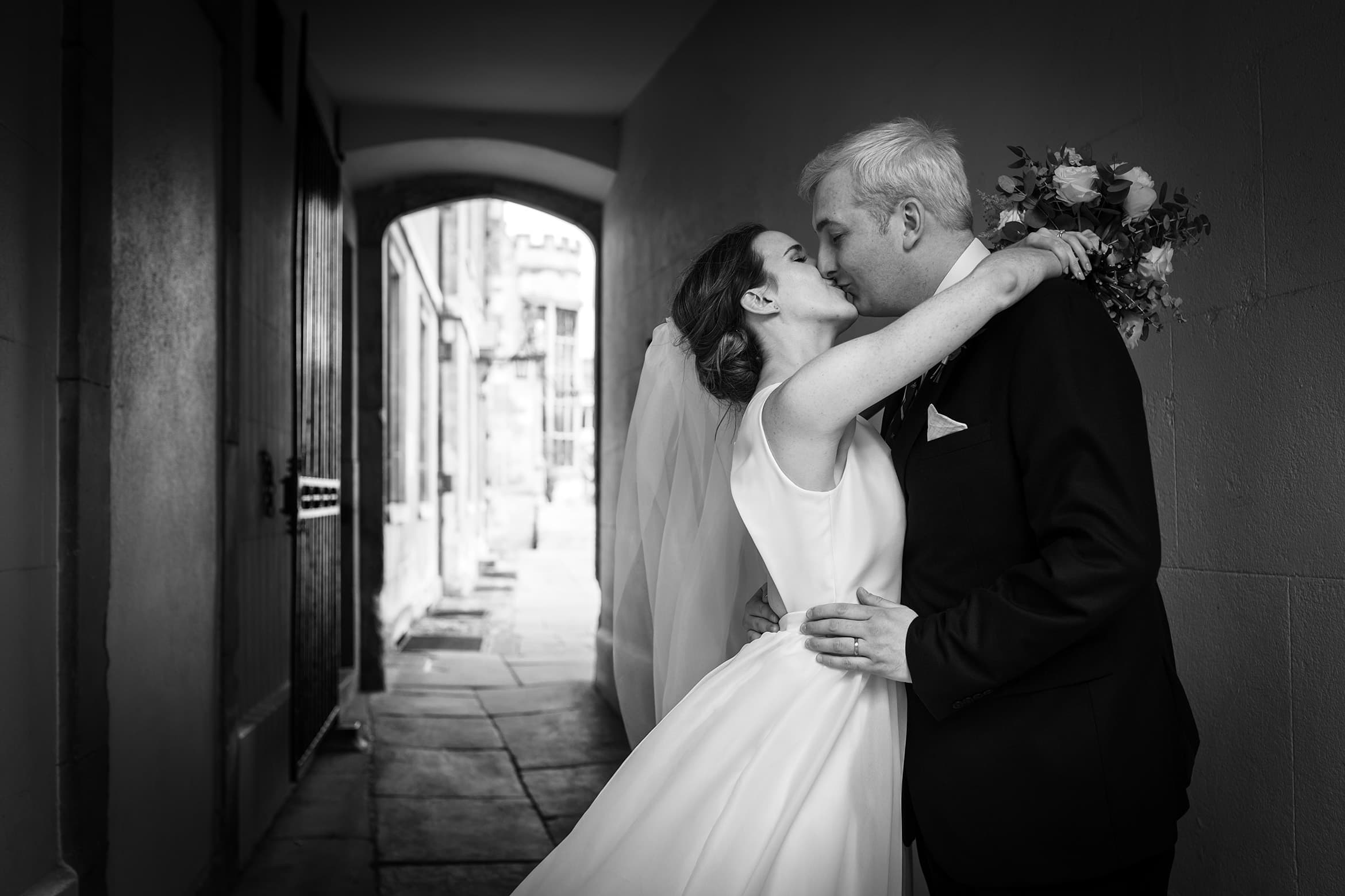 bride and groom at a cambridge college wedding