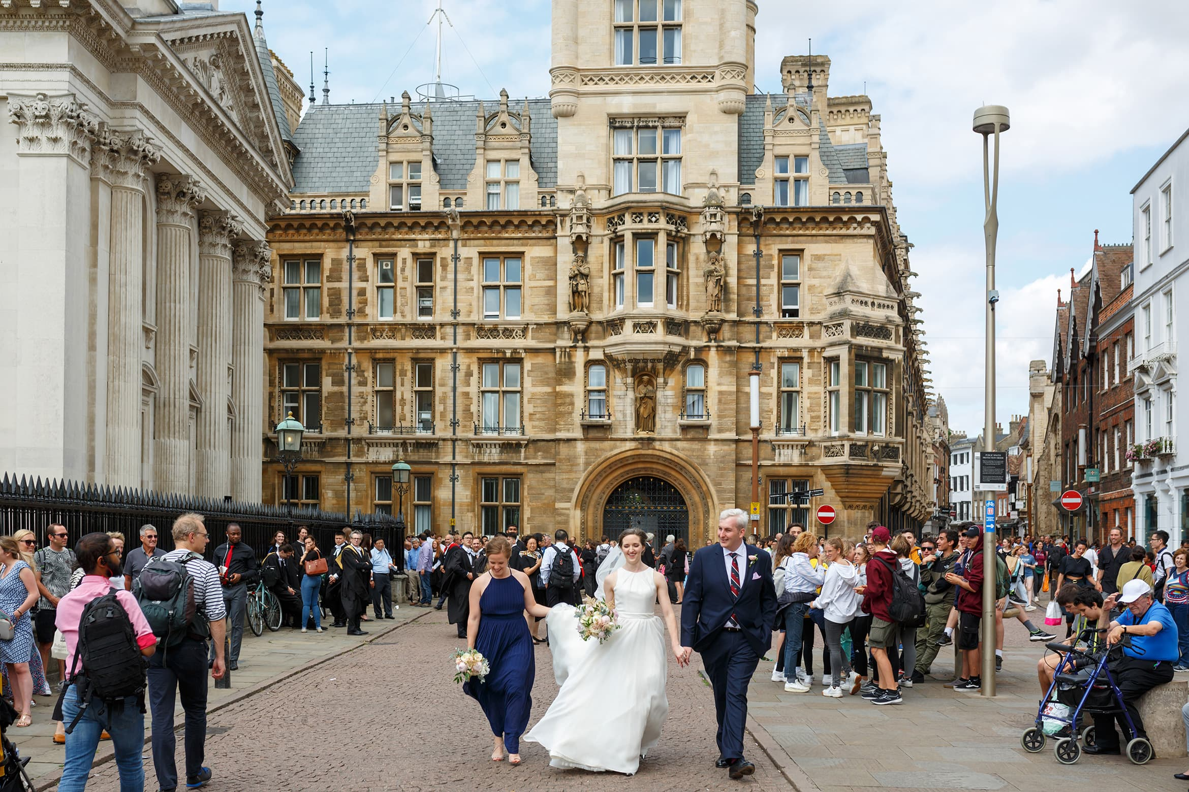 walking through the streets of cambridge on their wedding day