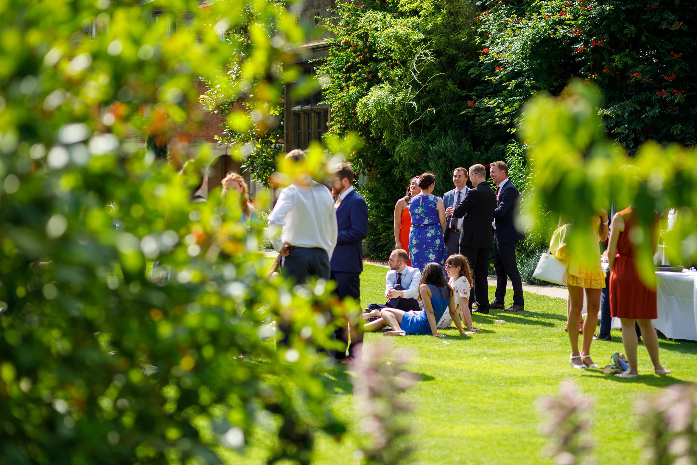 wedding guests on the lawn at pembroke college