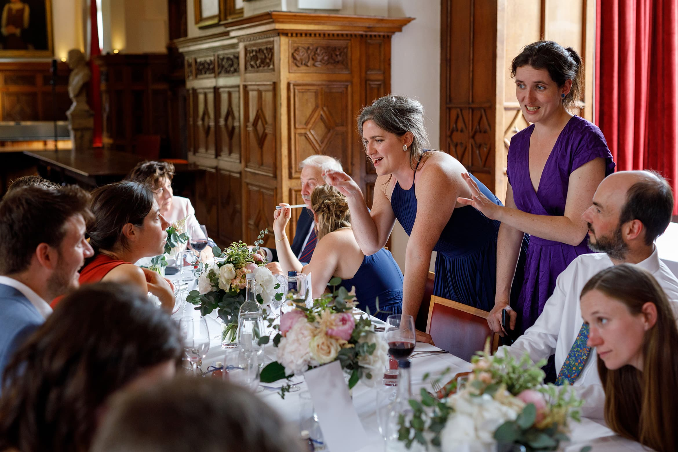 wedding guests chat at a cambridge college wedding