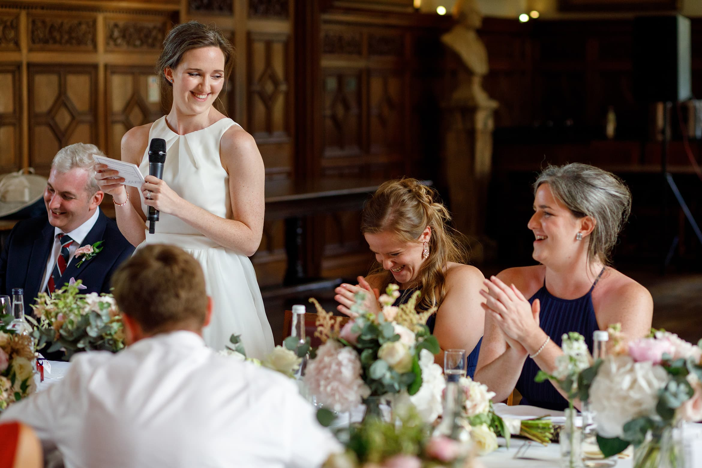 bridesmaids laugh at the brides speech