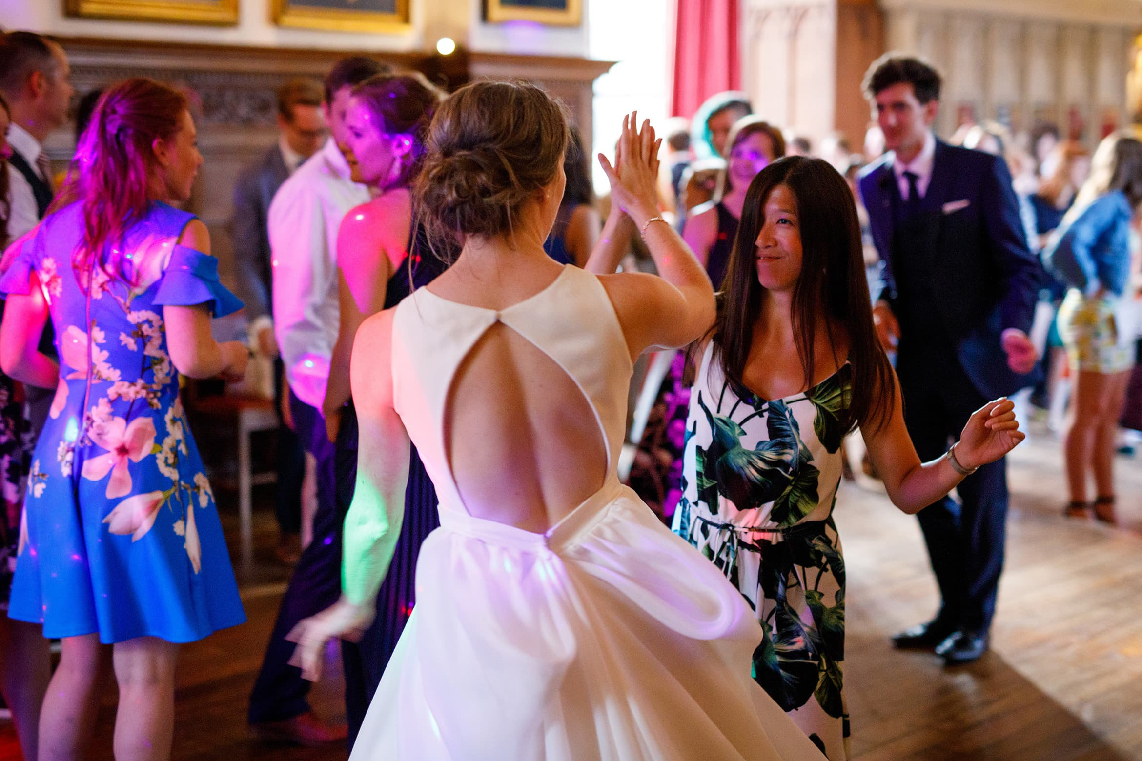 the bride dances with a guest