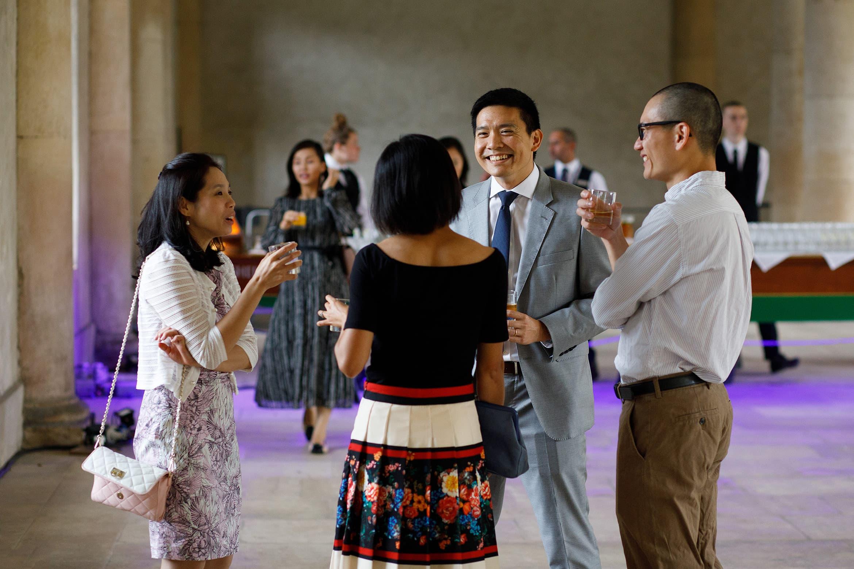 wedding guests enjoying a drink