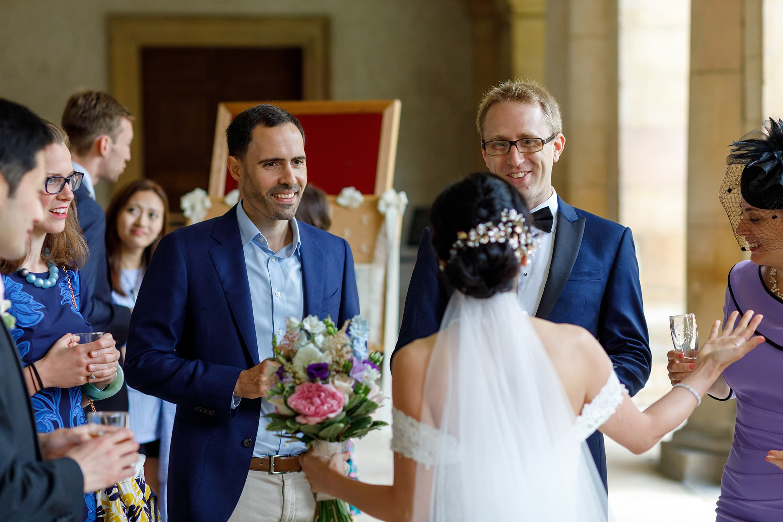 angella talks to her wedding guests